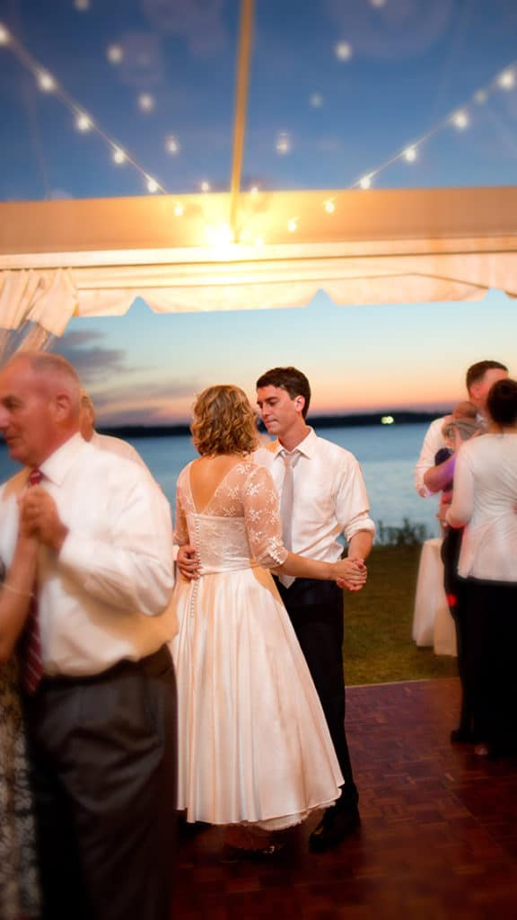 Kate and Wade dance under the tent during sunset.