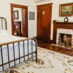 The Locke Rooms have an old-fashioned iron frame bed, two fireplaces, and plenty of chairs to rest.