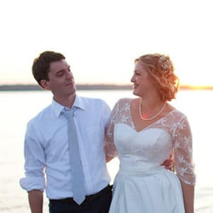 Wade and Kate stand on a wharf on the Wicomico River.