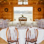 The reception barn can comfortably fit many tables for your guests.