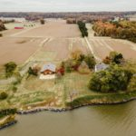 An aerial photograph that shows off the reception barn, Victorian manor, and proximity to the Wicomico River.
