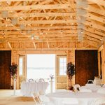 The wooden ceiling beams brighten up the barn and can be decorated with lights, tinsel, flowers, or anything you can dream up.