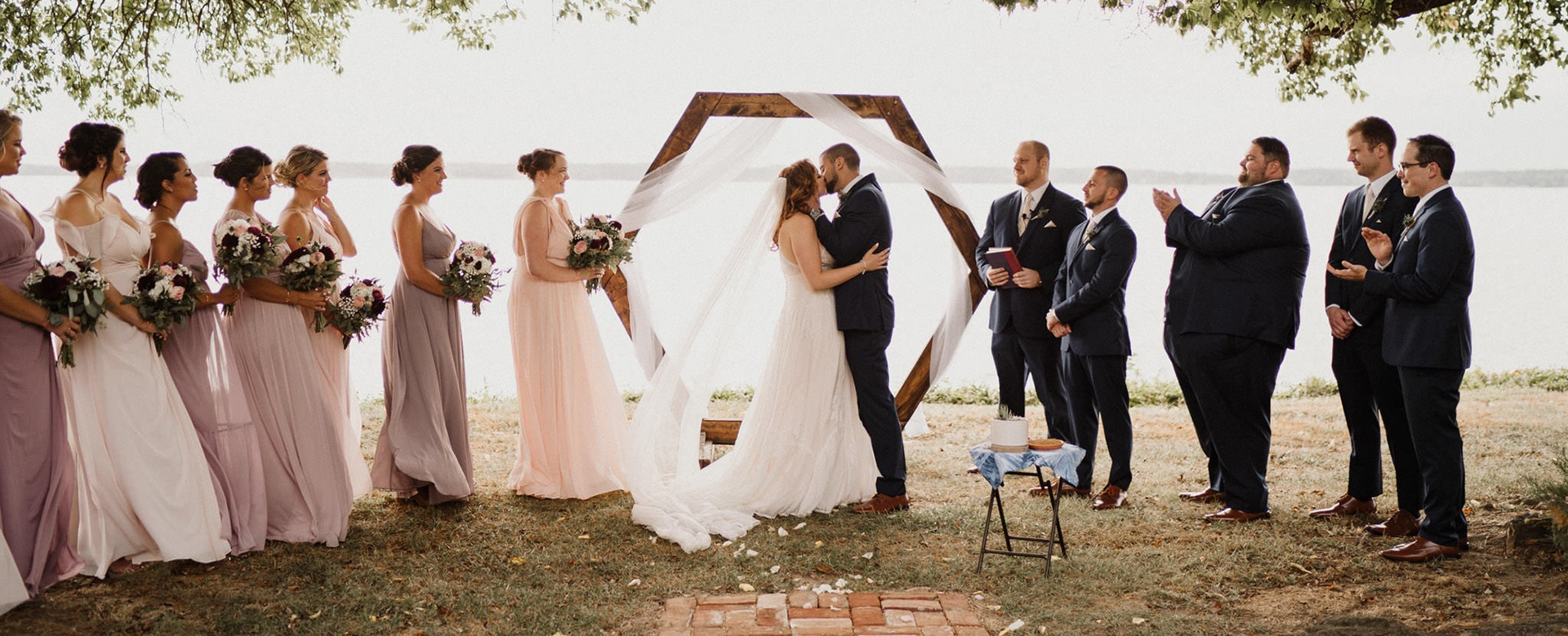 A wedding ceremony takes place in front of the Wicomico River.
